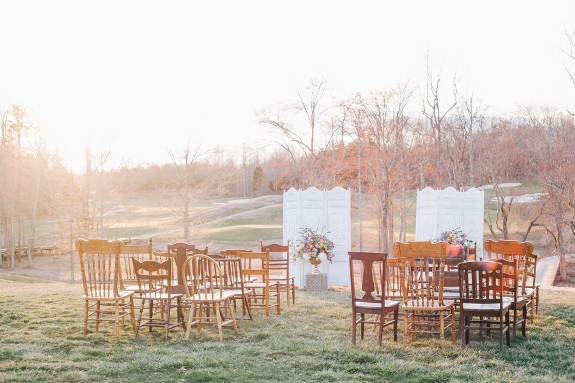 eclectic outdoor wedding ceremony setup