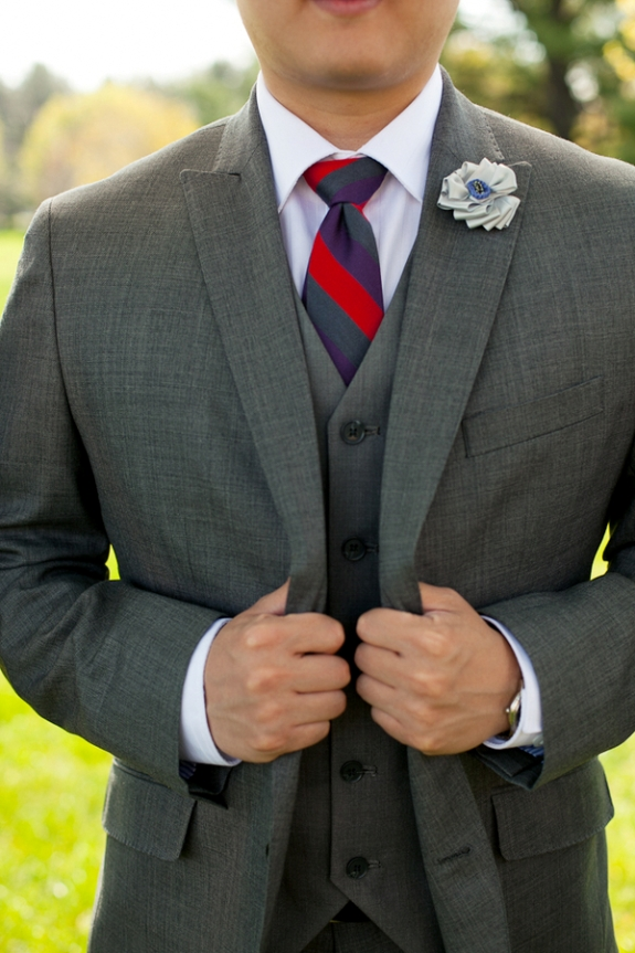 grey suit red striped tie groom