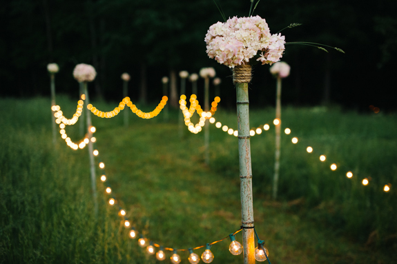 outdoor wedding ceremony lighted aisle