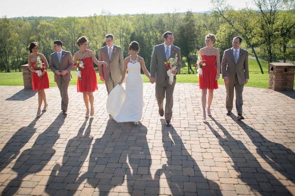 poppy red bridesmaids tan groomsmen