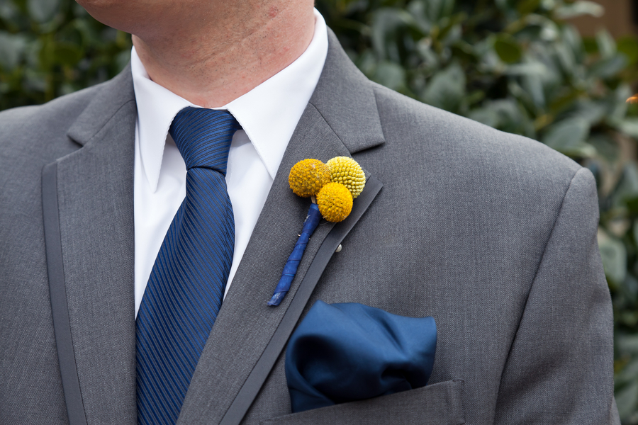 groom in grey suit billy ball boutonniere