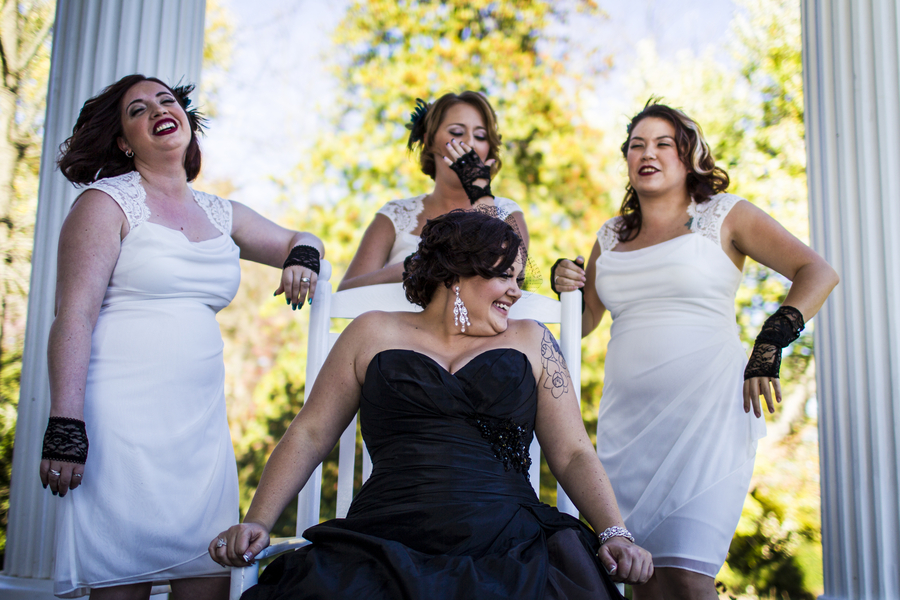 offbeat nontraditional bride black bridesmaids white dresses