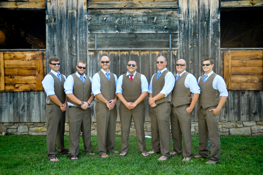 groomsmen in brown pants and vests