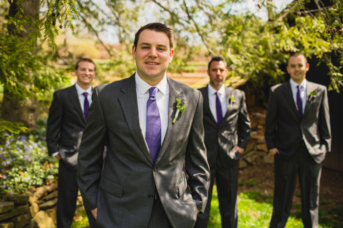 grey groomsmen suits purple ties